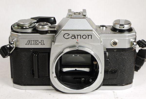 Canon AE-1 chrome camera body with guarantee/warranty