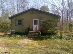 Older home on 3.67 wooded acres