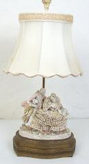 Porcelian figural lamp with original silk shade