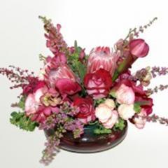 Queen protea and Mokara orchid arrangement