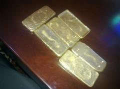 Gold dore bar and Rough Diamond