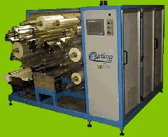 Optima capacitor winding machine.