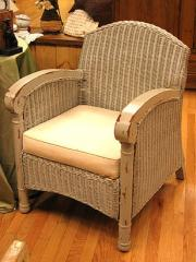 Wicker Chair With Scroll Arms And Cushion